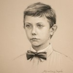 Charcoal and chalk drawing of boy on toned paper.